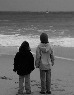 Kids on Beach Watching a Fishing Boat