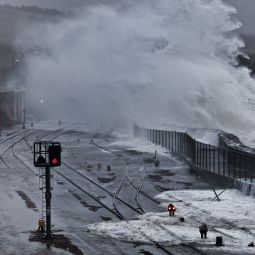 Waves over Penzance train line