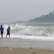 Dodging the waves at Marazion