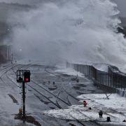 Waves over Penzance train line