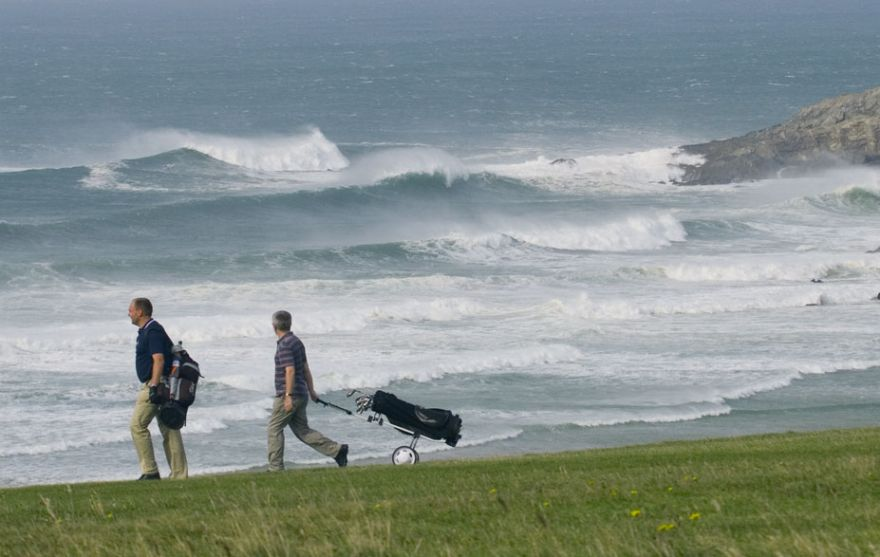 Golf with Big Surf Backdrop