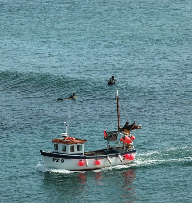 Porthleven Fishing Boat and Surfers
